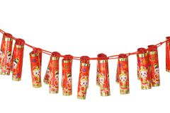 Chinese new year fire craker ornaments. Chinese new year fire cracker ornaments hanging horizontally on white with copy space