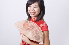 Chinese new year girl with fan Stock Photos