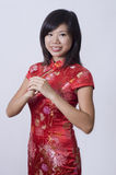 Chinese new year girl giving greeting Royalty Free Stock Photos