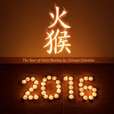 Chinese new year greeting card with evening tea light candles in form of 2016 Royalty Free Stock Photos