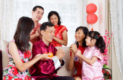 Chinese new year greetings. Asian family celebrating chinese new year