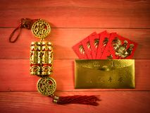 Chinese New Year items. Assorted items associated with Chinese New Year on a wooden plank background Stock Photo