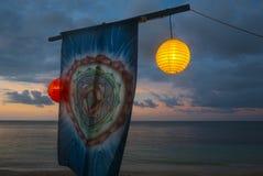 Chinese New Year lanterns and mandala decorations on the beach i Royalty Free Stock Image