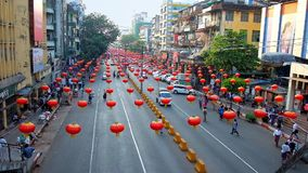 Chinese New Year lanterns in Yangon, Myanmar. YANGON, MYANMAR - FEBRUARY 14, 2018: The Maha Bandula road in Chinatown is decorated with red lanterns to the stock footage