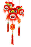 Chinese new year lion head ornaments. Three hanging Chinese new year lion head ornaments on white background