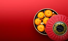 Mandarin oranges and chinese gold sycee. Chinese New Year - Mandarin oranges and chinese gold sycee in traditional container royalty free stock photo