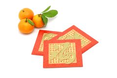 Chinese New Year mandarin oranges and red packets. On white background Royalty Free Stock Images
