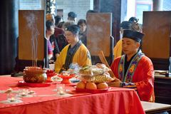 CANTON, CHINA – CIRCA FEBRUARY 2019: The taoist priests hold a requiem for the dead. Chinese New Year memorial service hold in the taoist temple in royalty free stock photography