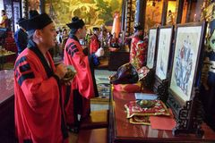 CANTON, CHINA – CIRCA FEBRUARY 2019: The taoist priests hold a requiem for the dead. Chinese New Year memorial service hold in the taoist temple in stock image