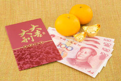 Chinese new year with money yuan banknote and ingot Royalty Free Stock Photos
