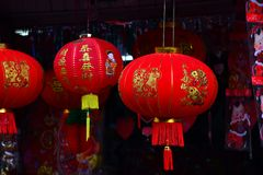 Chinese New Year. The New Year`s Day of the Chinese people. Lamps and red garments for use during Chinese New Year. The New Year`s Day of the Chinese people Royalty Free Stock Images