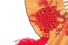 Chinese new year ornament. Closeup of Chinese lucky knot on paper fan Royalty Free Stock Image