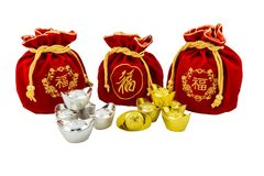 Decoration of chinese gold ingots and Red fabric or silk bag is. Chinese new year ornament Decoration of chinese gold ingots and Red fabric or silk bag isolated Royalty Free Stock Image