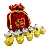 Decoration of chinese gold ingots and Red fabric or silk bag is. Chinese new year ornament Decoration of chinese gold ingots and Red fabric or silk bag isolated Stock Photography