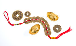 Chinese New Year ornament, gold coins and ingots on white backgr Stock Photography