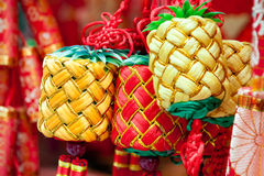 Chinese new year ornament - group of tied knots. Chinese new year ornament: Tied konts hanging in a traditional open market stock photo