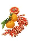 Chinese new year ornament and mandarin oranges. Chinese new year fire cracker ornament and mandarin oranges on white background