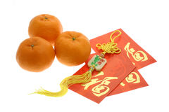 Chinese New Year ornament, oranges and red packets. On white background Royalty Free Stock Photos