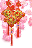 Chinese new year ornaments. Chinese new year traditional ornaments on cherry blossom background