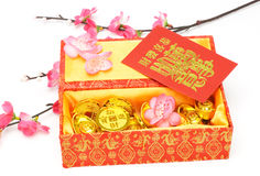 Chinese new year ornaments and red packets. Chinese new year gift box, red packets and ornaments on white background