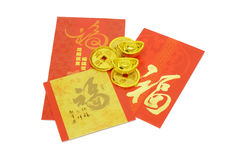 Chinese New Year ornaments and red packets. Chinese New Year ornaments gold coins, ingots and red packets Royalty Free Stock Photos