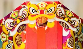 Chinese new year paper lion toy, all the Chinese means happy. And lucky stock images