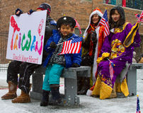 Chinese New Year Parade With Child Waving Flag stock photo