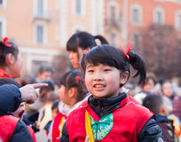 Chinese New Year parade in Milan. MILAN, ITALY - FEBRUARY 10: Child in traditional costume in the Chinese New Year parade in Milan on February 10, 2013 royalty free stock images