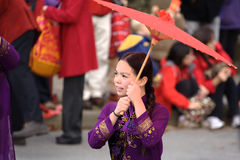 Chinese New Year Parade, Tết Vietnam. A child in traditional Vietnamese dress holds a parasol as she marches in the Vietnamese contigent of the 2013 Lunar New Royalty Free Stock Photos