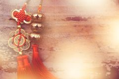 Chinese new year pendants. On a wood background Stock Photo