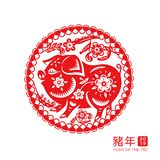 2019 chinese new year pig zodiac sign. With flowers and branches in ornamental circle. Xin Nian characters for spring festival or CNY. Decorative paper cut for stock illustration