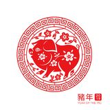 2019 chinese new year pig zodiac sign. With flowers and branches in ornamental circle. Xin Nian characters for spring festival or CNY. Decorative paper cut for royalty free illustration
