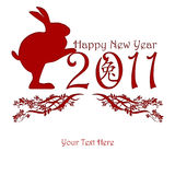 Chinese New Year Rabbit Holding 2011. Red with Peony Flowers Motif Royalty Free Stock Photography
