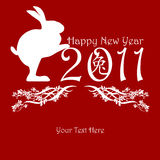 Chinese New Year Rabbit Holding 2011. Red with Peony Flowers Motif Stock Photo