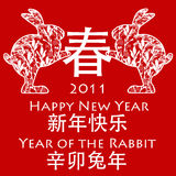 Chinese New Year Rabbits Holding Spring Symbol. Chinese New Year Rabbits holding Spring Chinese Symbol 2011 Red Background Royalty Free Stock Photos