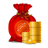 Chinese New Year. Red bag for Chinese New Year and golden coins isolated on white background Royalty Free Stock Image