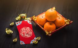 Chinese New year,Red envelope packet ang pow with gold ingots Royalty Free Stock Photos