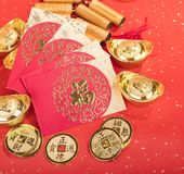 Chinese New year red envelope packet with gold ingots on red paper,Chinese Language on envelop mean Happiness. And on ingot and coin mean Wealthy royalty free stock photos