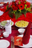Chinese new year red envelope. Set up on table with flowers and plates