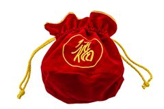 Chinese New Year Red fabric or silk bag, ang pow of luck isolat. Chinese New Year Red fabric or silk bag, ang pow of Traditional chinese isolated on white royalty free stock image