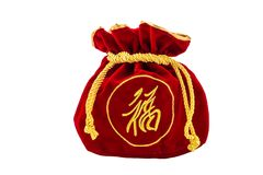 Chinese New Year Red fabric or silk bag, ang pow of luck isolat. Chinese New Year Red fabric or silk bag, ang pow of Traditional chinese isolated on white royalty free stock images