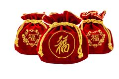 Chinese New Year Red fabric or silk bag, ang pow of luck isolat. Chinese New Year Red fabric or silk bag, ang pow of Traditional chinese isolated on white stock photography