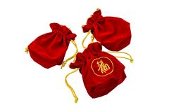 Chinese New Year Red fabric or silk bag, ang pow of luck isolat. Chinese New Year Red fabric or silk bag, ang pow of Traditional chinese isolated on white stock photo