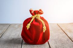Chinese New Year Red fabric or silk bag, ang pow of luck. Chinese New Year Red fabric or silk bag, ang pow of Traditional chinese on old wooden table royalty free stock images