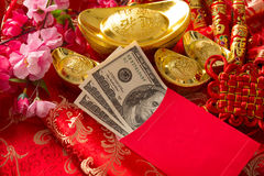 Chinese new year red packet with dollars inside. Chinese new year festival decorations, red packet is given to children and elders during chinese new year for stock photo