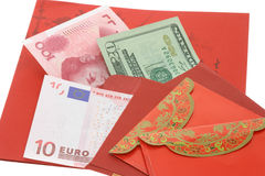 Chinese New Year red packets and currency notes. On white background Royalty Free Stock Photo