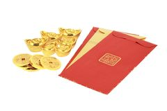 Chinese new year red packets and gold ingots. On white background Royalty Free Stock Photo