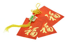 Chinese New Year red packets and ornament. On white background Royalty Free Stock Images
