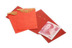 Chinese New Year red packets and renminbi notes. On white background Stock Photos