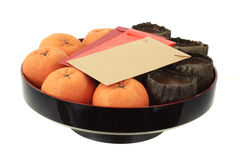 Chinese new year rice cake and mandarin oranges Stock Images